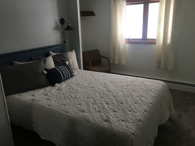 Main bedroom has a queen bed.
