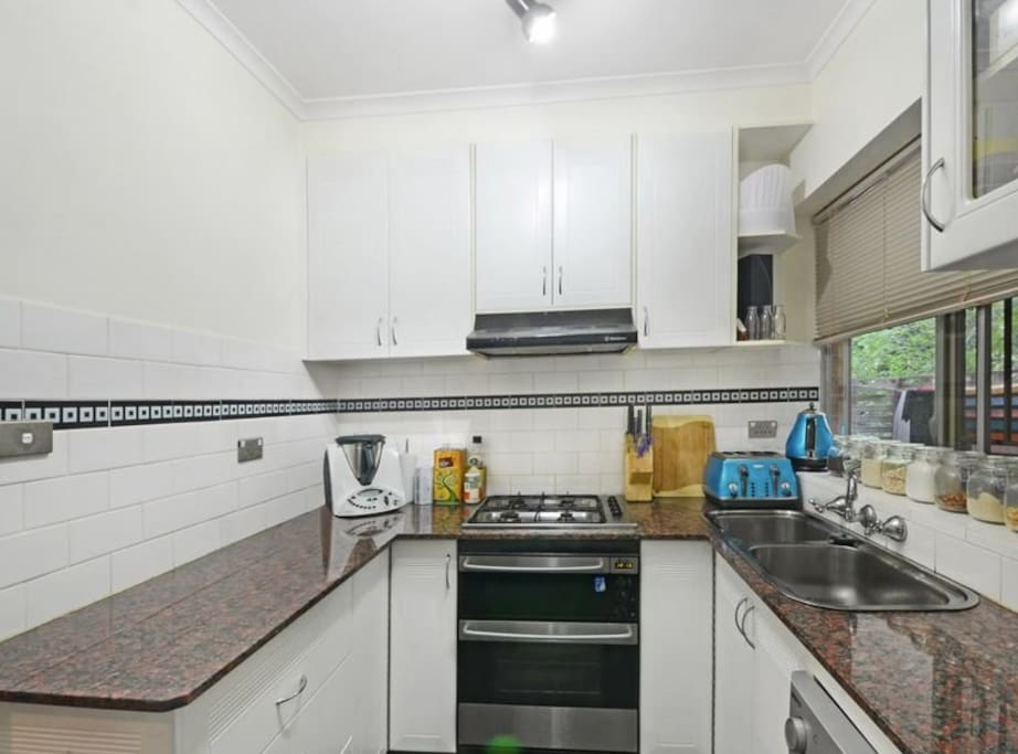Kitchen with dishwasher and gas cooking facilities