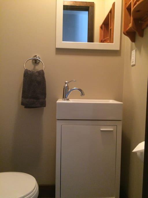 Tiny powder room off master suite