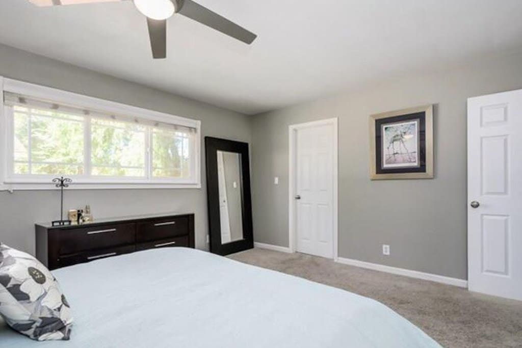 Large master bedroom with private closet and bathroom stocked with all the toiletries you need.