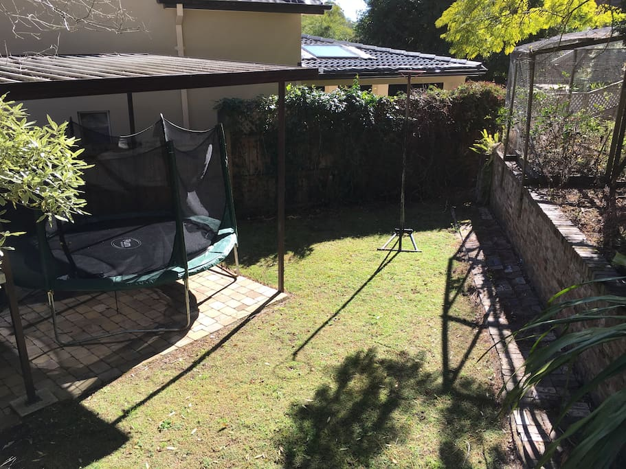 The lower garden holds the carport, there is also a basketball hoop.