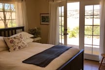 Bedroom 3 Queen bed French doors Gorgeous views Ceiling fan