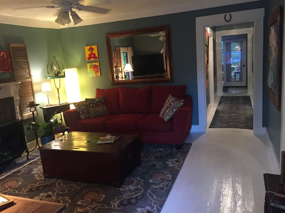 Front entry into living room, through to hallway