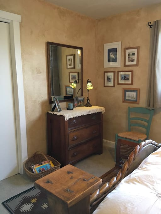 Dresser, mirror and chair in bedroom 1