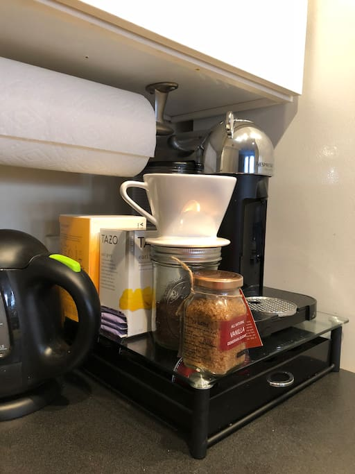 """Nespresso maker, Blue Bottle pour over set with local coffee grounds. Electric kettle with Starbucks tea assortment. Indian vanilla brown sugar and a milk frother available for """"that perfect cup"""" ;)  I will aim to always have organic whole milk available for use on the top shelf in the fridge"""