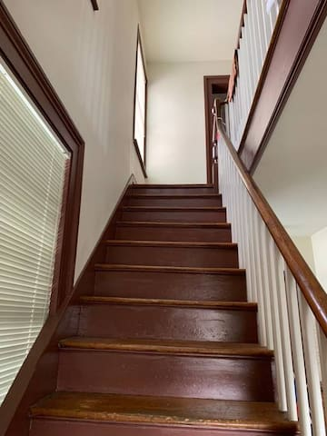 Stairs to your second floor guest suite.