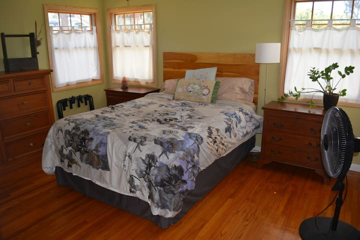 Bedroom 1: Comfortable queen bed with closet, dresser and nightstands on each side. Luggage racks and fan included.