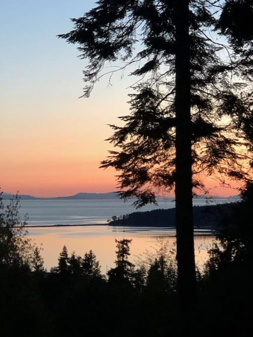 Beautiful sunsets and sunrises on this water-view property. You can see Canada on the horizon.