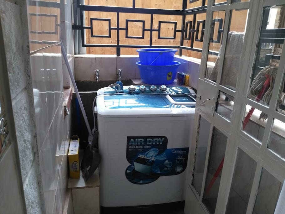 There is a top loader wash and dry washing machine.