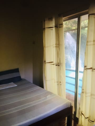 Sleep near the Kawasan Falls!