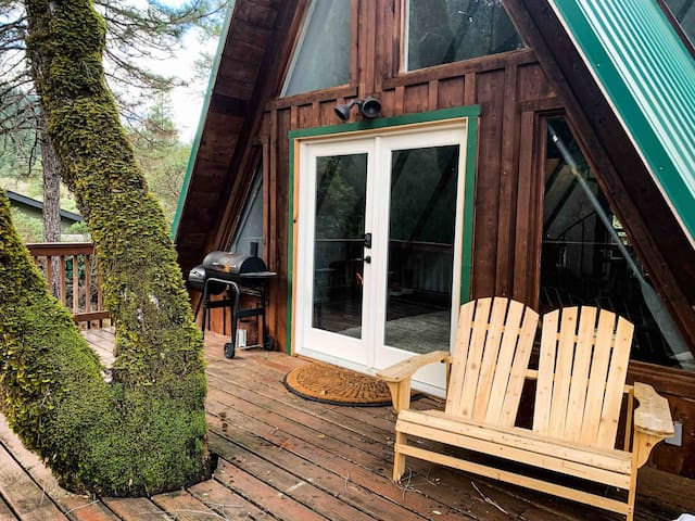 Cozy A-frame cabin with spacious deck, fireplace, gas grill, and forest views