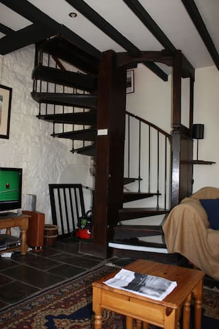 Spiral staircase off lounge area