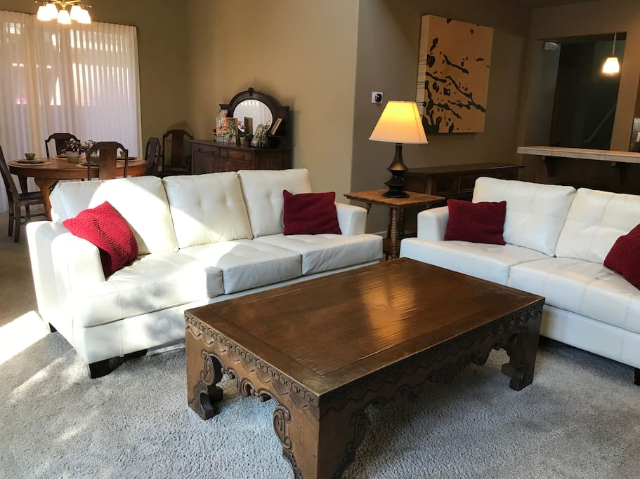 The family room features two sofas that comfortably seat five to six people. The television swivels to face the family room.
