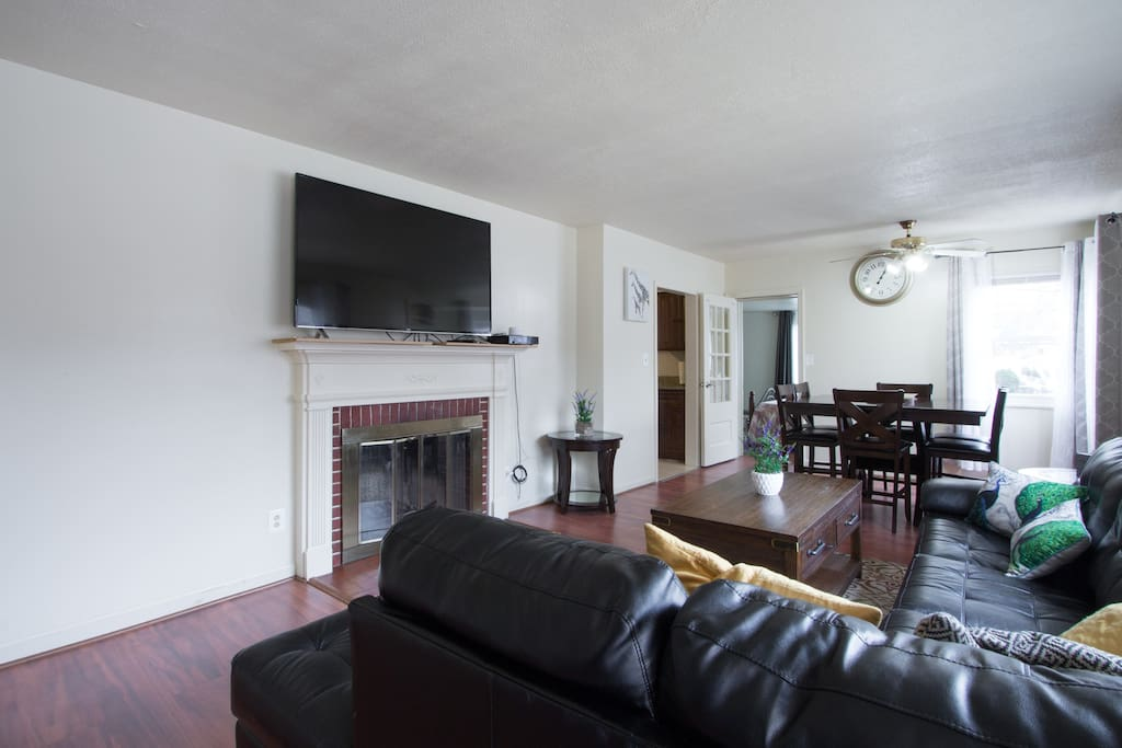 This living room features a 60 inch television for your viewing pleasure.
