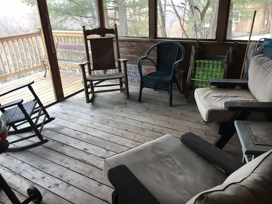 Here's the screened porch which is a joy on warm and buggy nights. There's a small gas grill tucked in the corner you can take on the deck!