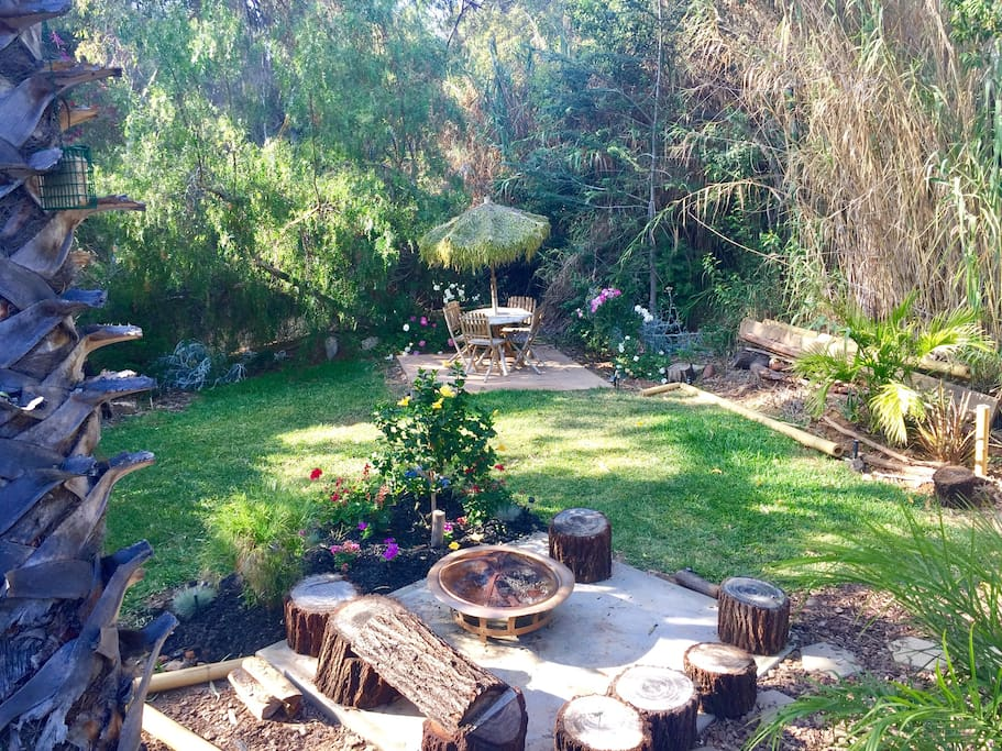 Overlooking fire Pit area, lawn area and Tiki table set