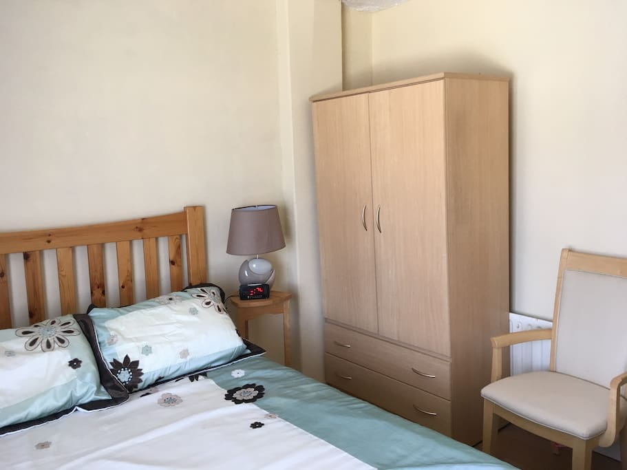 Alarm clock, wardrobe with plenty of storage