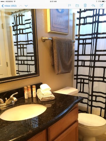Bathroom #1 includes a tile floor, tub & shower combo with Granite counter and medicine cabinet. Towels are included.