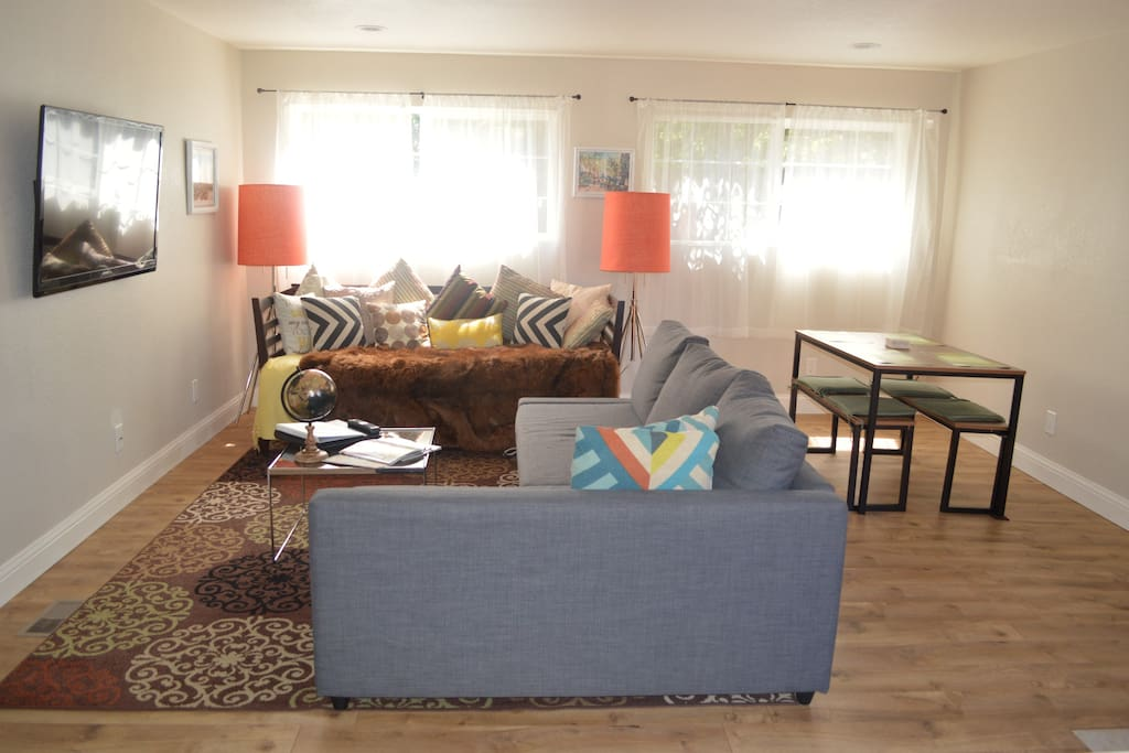 Large Living Room with Sunny and Bright Dinning Area; 50 inch flat screen cable tv so you can watch all your favorite shows.  Sofa turns into a double bed. Twin day bed also
