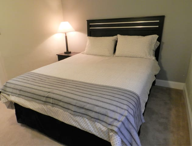 Comfortable beds with dark shades for a relaxing night