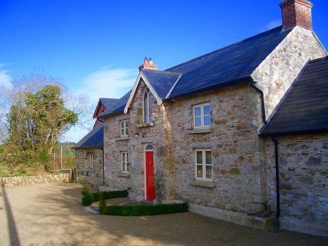 Unique farm house nestled in 20 beautiful acres