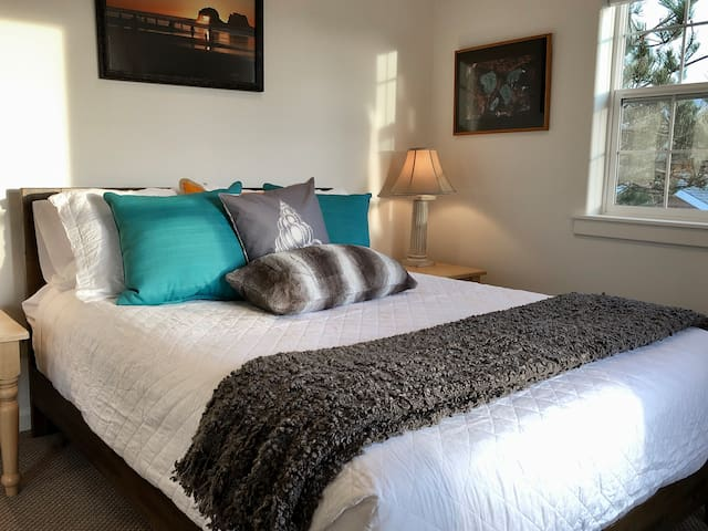 Bedroom two with queen bed.