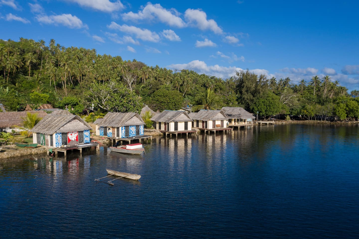 Our bungalows are right on the water. As you can see, we also have 50hp powerboat and traditional canoe for our guests.