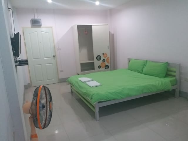 Clean Standard Room with Fan at Chawalee Place