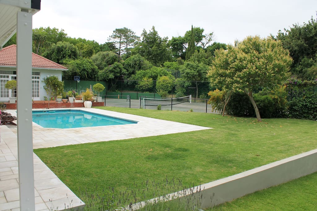 large swimming pool and tennis court