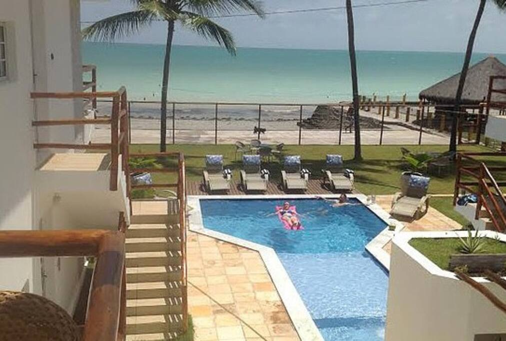 relax in the pool or step out onto the sand