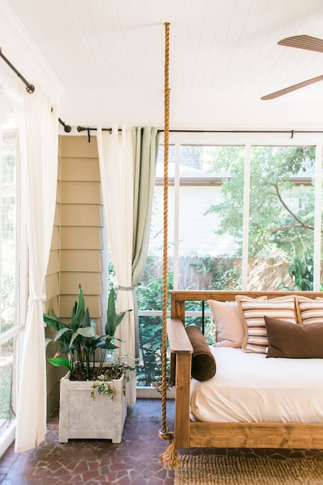 Hanging bed swing on the screened in porch