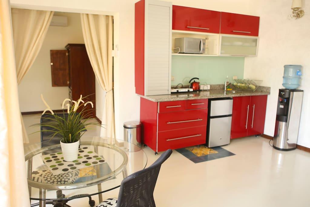 Apartment room has kitchenette