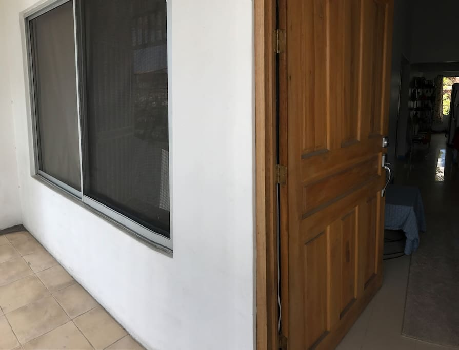 The entrance balcony and window for first bedroom