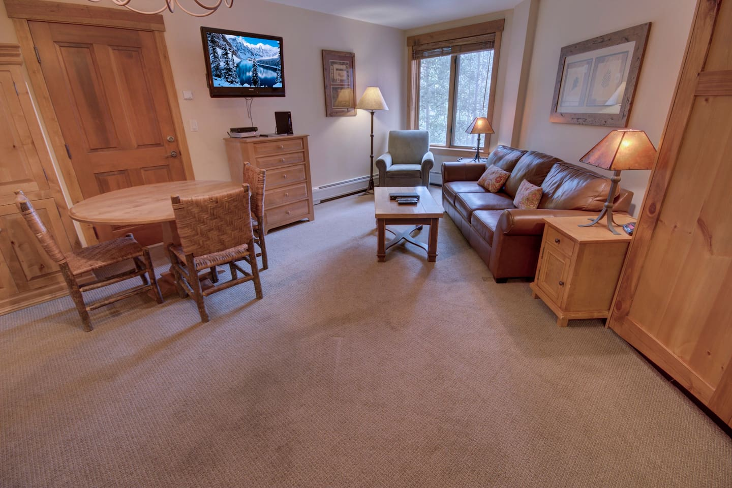 Open living room with a TV and storage