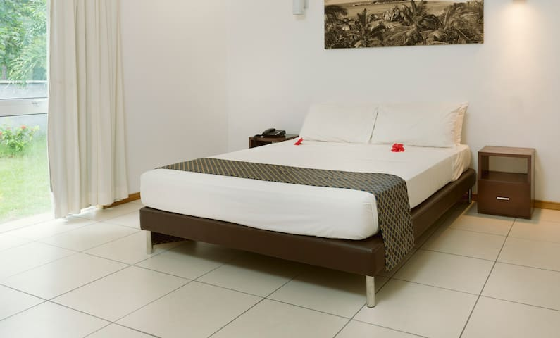 Bedroom with double bed and bedside table