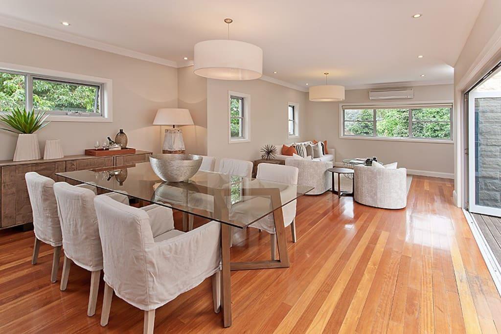 Living dining area flowing out to the outdoor deck