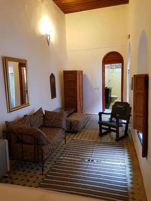 opposite view toward the room's exit and en suite shower room