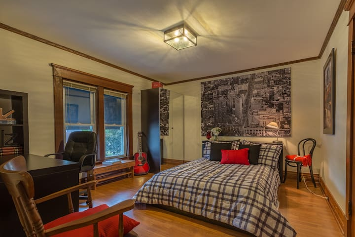 This queen sized bed is one of 3 bedrooms.