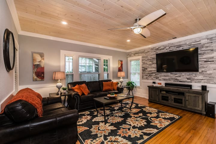 """Huge living room with modern decor and accents will welcome you when coming in to relax.  Beautiful tongue and groove ceiling with wall controllers to dim the lights.  70"""" Samsung smart TV for your entertainment."""