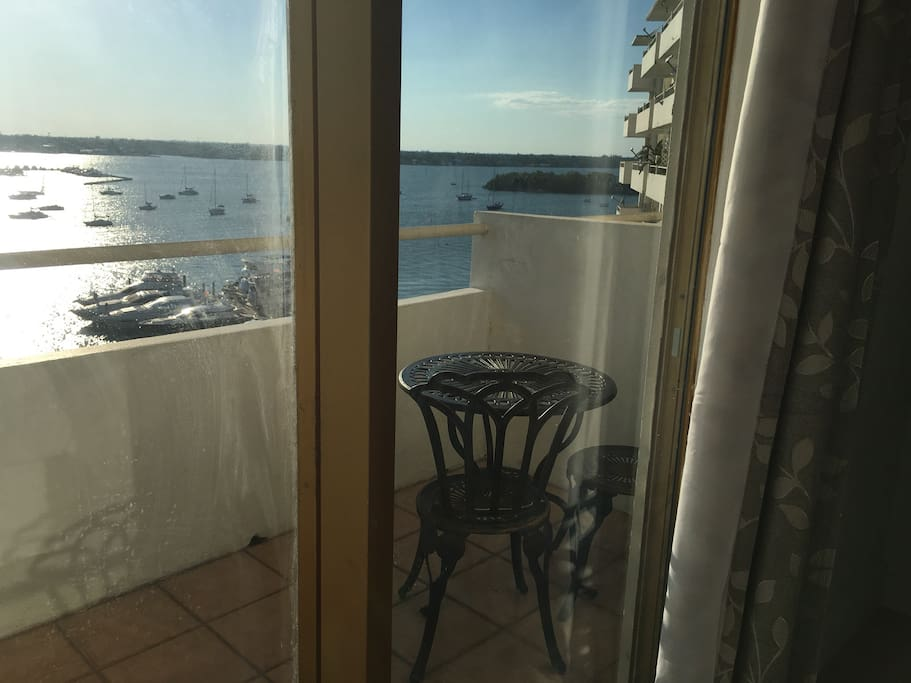 Balcony with table and two chairs.  Biscayne Bay view