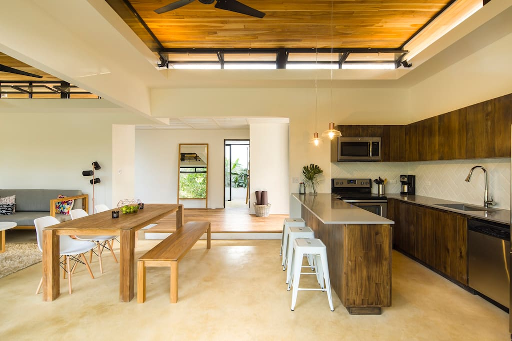 Kitchen with all modern appliances, opens up to the pool deck