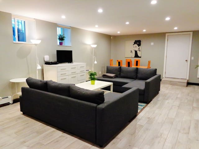 1st Floor: Spacious living area includes free high-speed WiFi and cable TV.