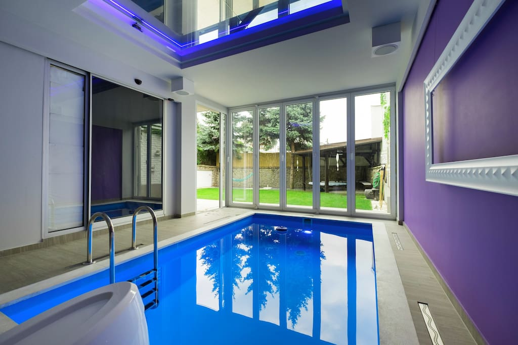 Indoor heated pool with propulison system