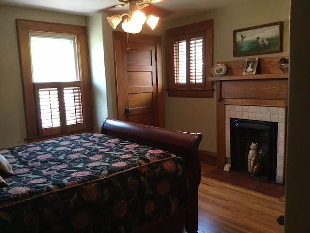 Upstairs queen bedroom with fireplace