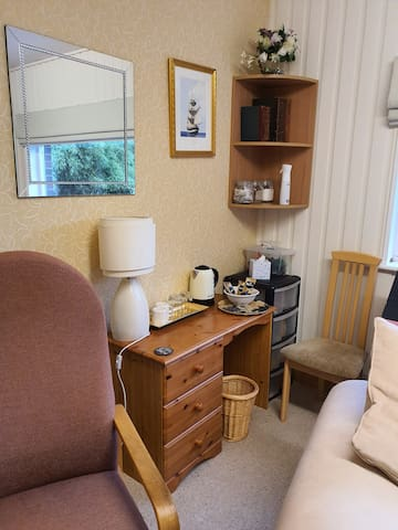 Guest lounge with double bed settee, children's toys, jigsaws and family games for your use.