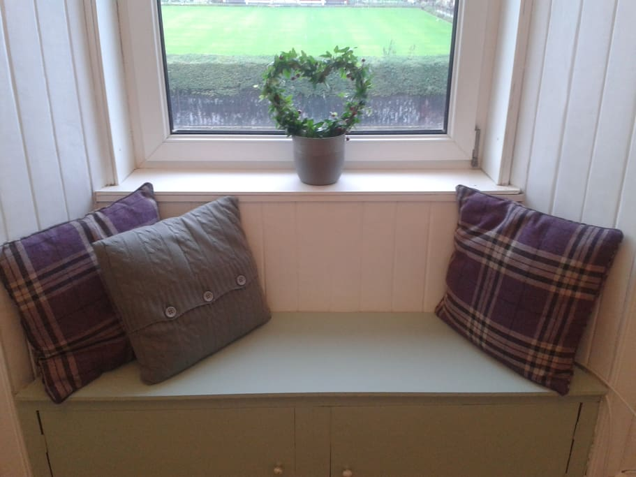Cosy window seat, ideal for a morning cuppa!