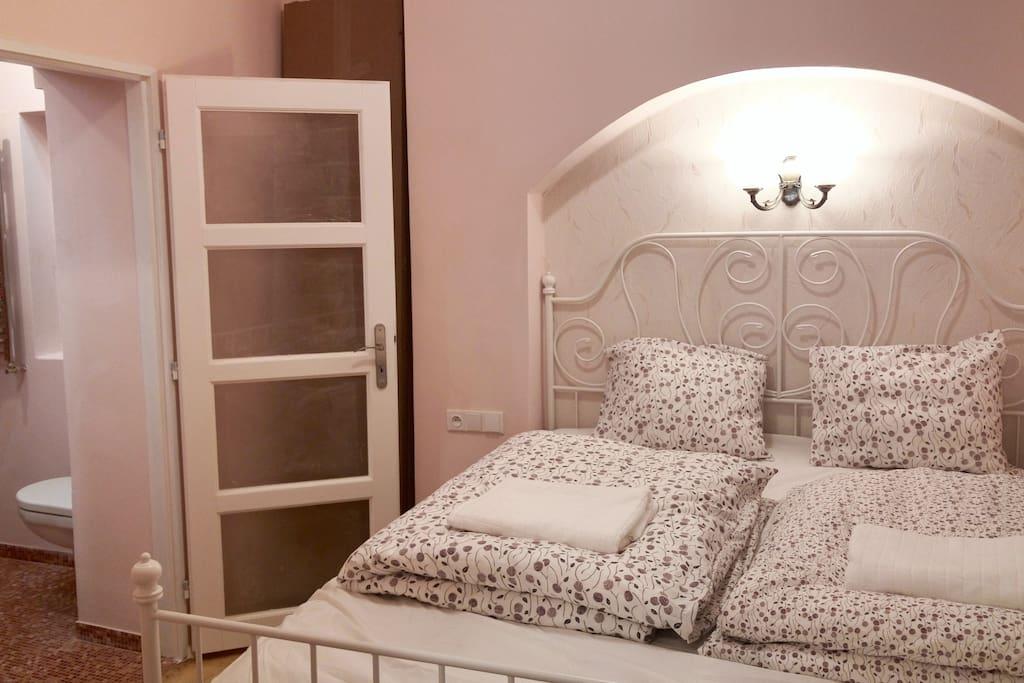 Second bedroom features en-suite bathroom with shower.