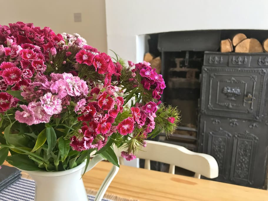 Fresh flowers and the original range in the dining room