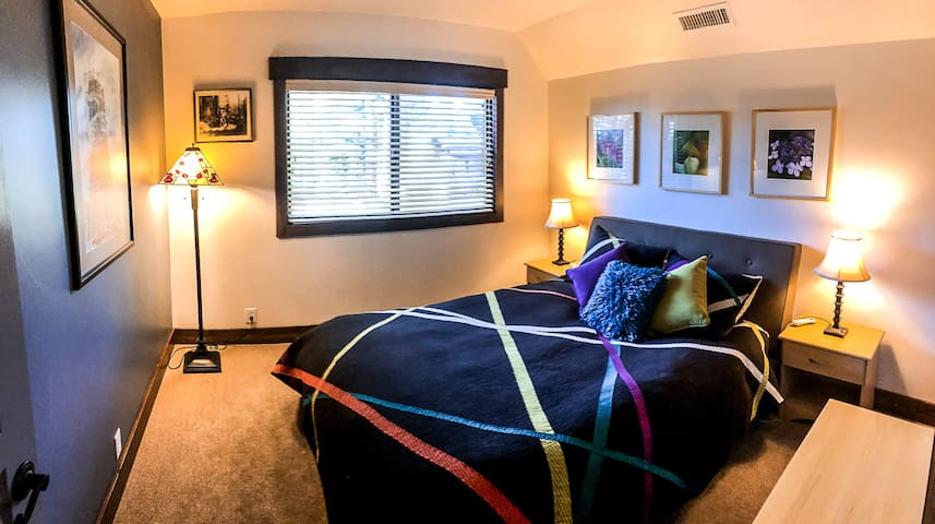 Room 2 - queen bed. Closet is to the right. We have a new chest at the foot of the bed now, power strip with 2 USB plugs as well.