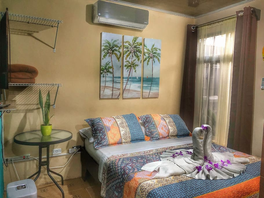 """Cozy bedroom with queen size bed, A/C and 32"""" plasma TV with cable (bed lines and blanket included)."""